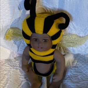 Porcelain bumble bee doll